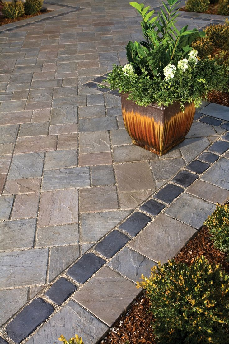 I like the way the pavers are arranged and maybe the darker thin border for down by the walkout basement sliding door