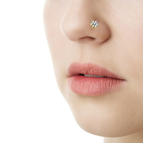 Wear the innocence and beauty of a flower with this Indian nose ring in 18K yellow gold with 7 diamonds in prong setting. A diamond jewellery gift for yourself this Diwali!
