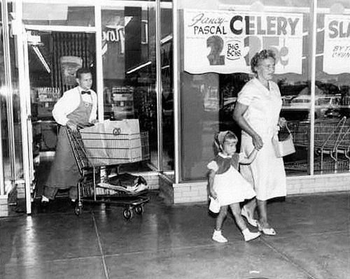 Grocery Cart Valet. Wow I almost forgot about these. Just go get your car and pull it up to the curb. They not only pushed the cart out of the store for you, then they loaded it! Sweet days gone by!