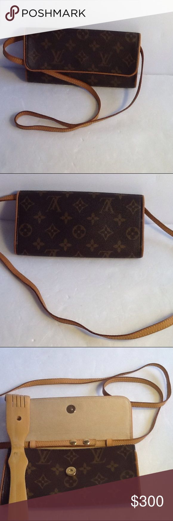 Authentic Louis Vuitton Pochette Twin Monogram Bag Leather and strap showed light wearing. The bag was bade in France with a date code CA 1001. The bag came with a shopping bag. The dimension is 7, 4 and 1. Over all the bag us in a good condition. Louis Vuitton Bags Crossbody Bags