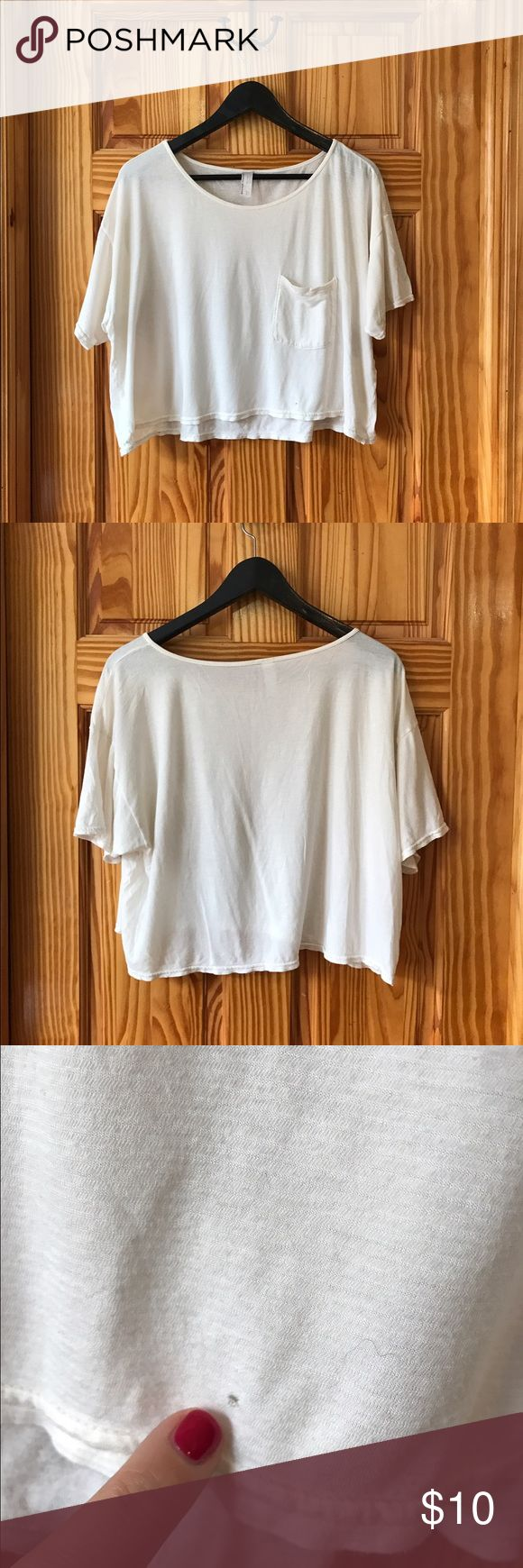 American Apparel flowy cream crop top American Apparel flowy cream crop top, one size. Lightly worn, there is a barely visible pull (pictured) on the front hem of the shirt. American Apparel Tops Tees - Short Sleeve