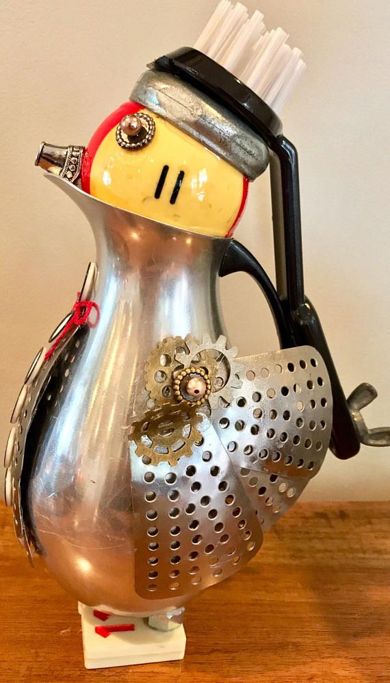 This cute assemblage is a combo, penguin & bird. Made with random found objects, stainless creamer, pool ball,strainer leafs,dish scrubber & other pieces of hardware. I think it is pretty cute! Stands, 9 tall