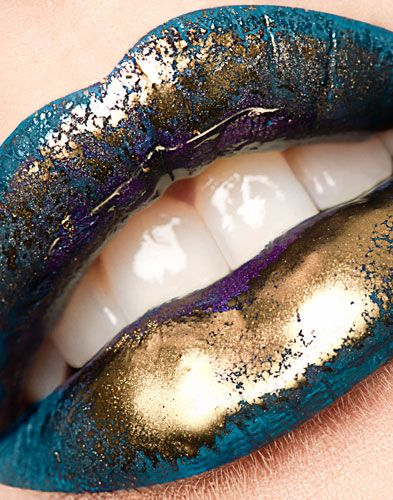 Stunning glossy blue and gold makeup for the eyes and lips. Photography by Charlotte Kibbles.