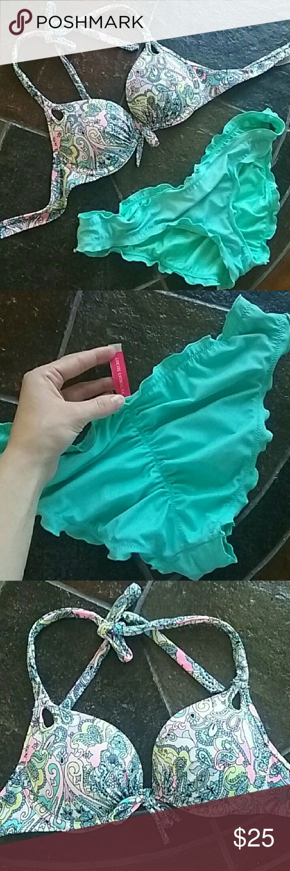 Victoria's Secret bathing suit set! The top is a 32A with bombshell padding and the ruffle cheeky bottoms are a size small. I purchased this from poshmark and it did not fit I never wore it but it is used. Victoria's Secret Swim Bikinis