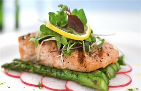 Our Herb-Baked Salmon on Asparagus is extremely heart-healthy, not to mention fish-tastic! It's delicious and ready in a little over 30 minutes. #HeartMonth