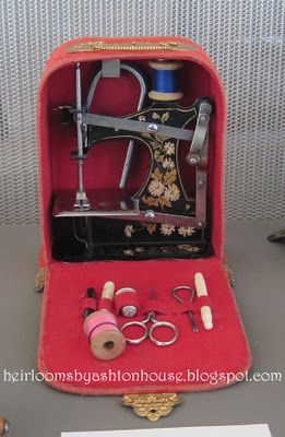 vintage sewing machine in a box.