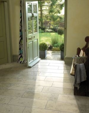 A stone-effect tile is perfect for an entry way - durable, low-maintenance and stylish.