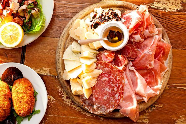 Il Salumaio on the Upper East Side - board with tagliere salumi e formaggi, octopus salad, and frittatine di pasta