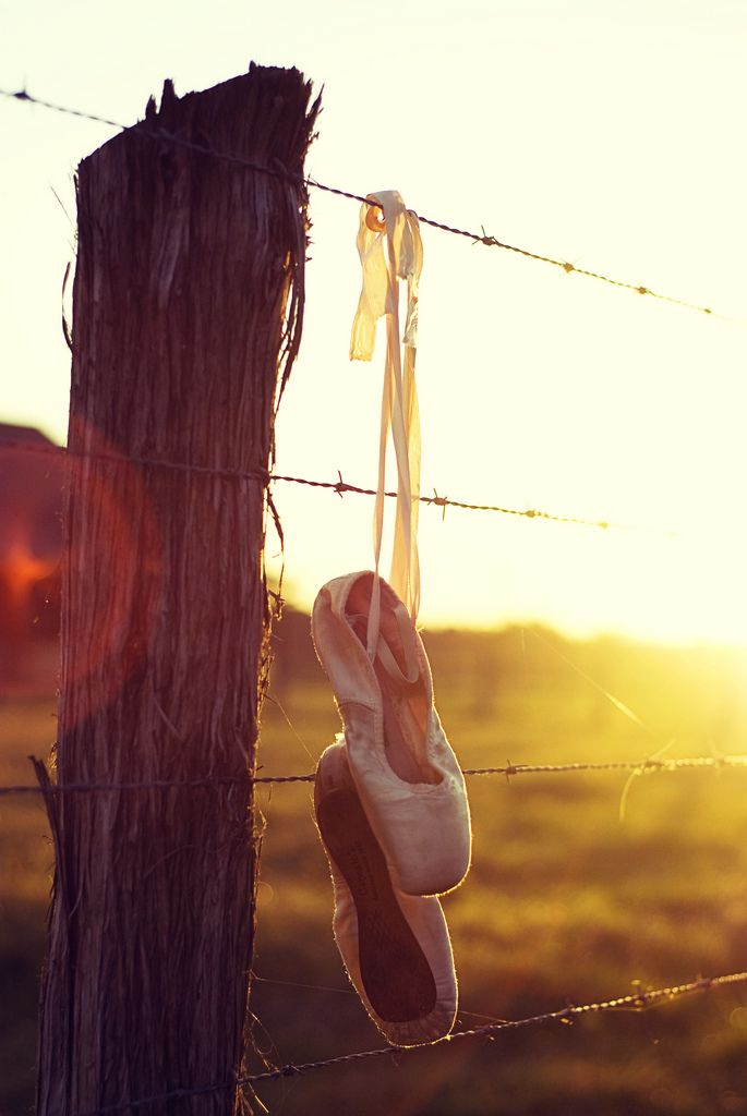 Ballerina shoes sunset dancer outdoors nature shoes country ballet rustic fence glare barb wire