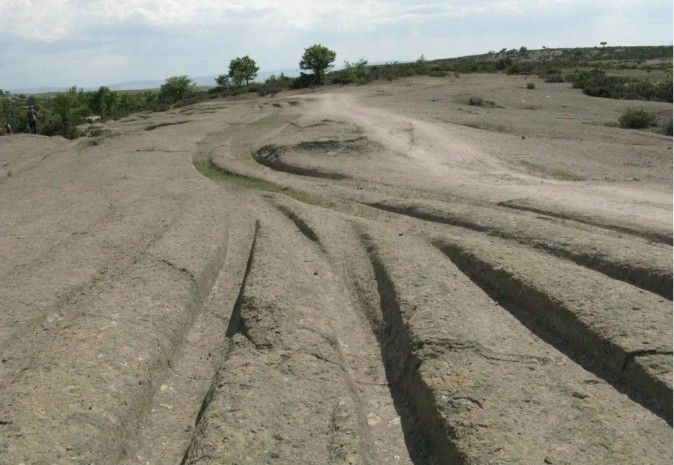 Geologist Dr. Alexander Koltypin hypothesizes that prehistoric ruts in stone were left by heavy-duty ancient vehicles—not light chariots or wagons.