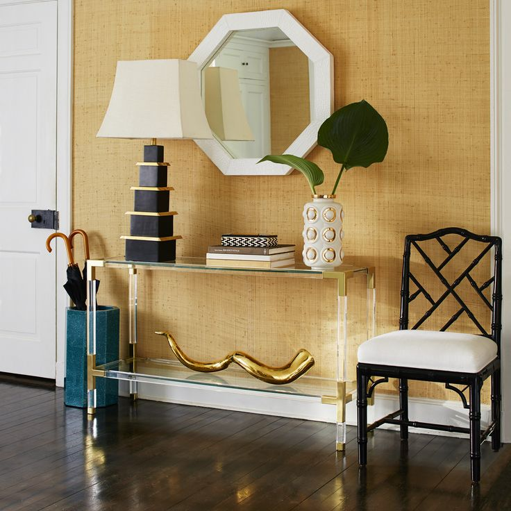 Clearly Cool.Our Jacques Collection is the perfect blend of simplicity and glamour, modern and traditional. Choose from crystal clear acrylic with brushed brass or moody smoke acyrlic with nickel corners. Fitted with a low glass shelf for baubles or books, our Jacques Console works perfectly behind a sofa or looks fab in a foyer. Big presence, weightlessly transparent.