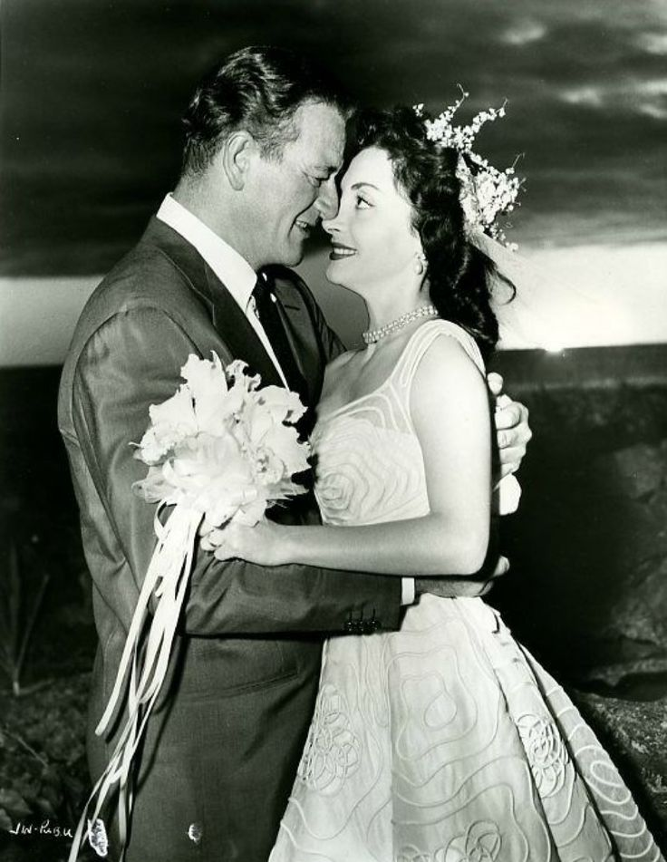 John Wayne and Pilar Pallete marry in Kona, Hawaii in 1954