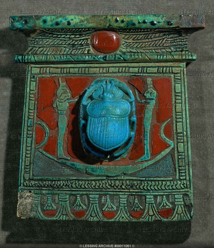 Egyptian Amulet ~ Pectoral of the Chief Ointment-maker Pa-nehersj. Two goddesses, Isis and Nephtys, praying to the scarab as a symbol of the sungod Ra. The scarab is seen in its morning-shape of Chepre, a symbol of rebirth. Carnelian faience (ca. 1200 BCE), New Kingdom, Egypt. Inv. 1984