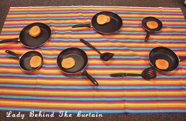 Lady Behind The Curtain - Pancake Toss Game Maybe fun for youth...  You could make the pancakes out of play dough ..