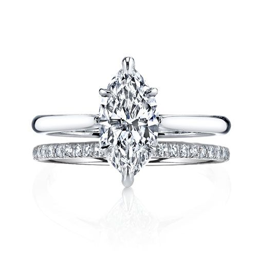 NINA is a handcrafted Jean Dousset solitaire engagement ring pictured with a Marquise cut diamond and matching, flush-fitting Angelina diamond wedding band, both in Platinum. JeanDousset.com #weddingring #engagementring #diamondengagementring
