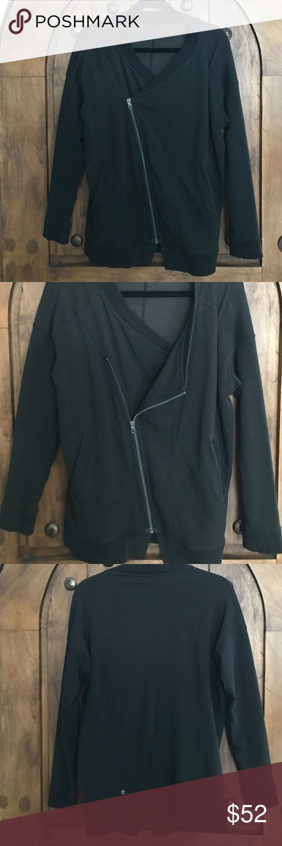 Lululemon black zip up jacket Great jacket angled zip up. Tiny gray pin strip. Label came out and I can't remember if it's a 8 or 10, I'm guessing 10 lululemon athletica Jackets & Coats