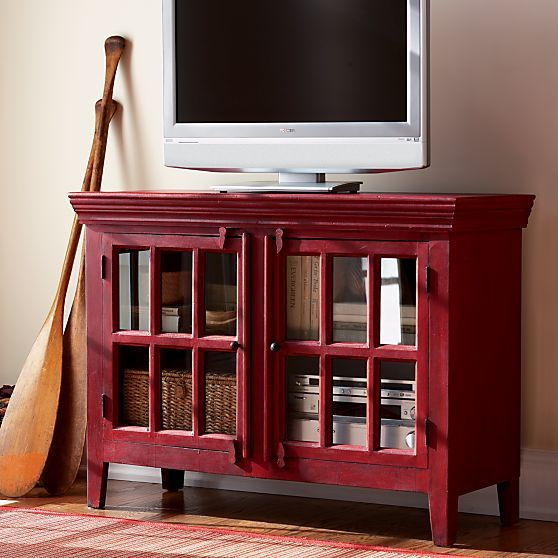 With all the warmth and rustic charm of a one-of-a-kind antique, the rich waxed patina, hand-forged iron hardware and wood hasp closures of this red media cabinet add instant character to any room.