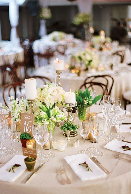 Eclectic Low White Floral Centerpieces . The tables were covered with flax linen tablecloths and decorated with arrangements of lilies of the valley, parrot tulips, peonies, Japanese sweet peas, and garden roses, as well as pillar candles and mercury glass votives.
