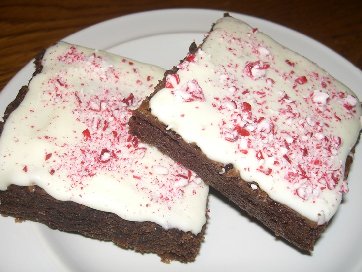 Our Peppermint Candy Crunch Fudge Brownies are covered with a blanket of snow and sprinkles of peppermint!