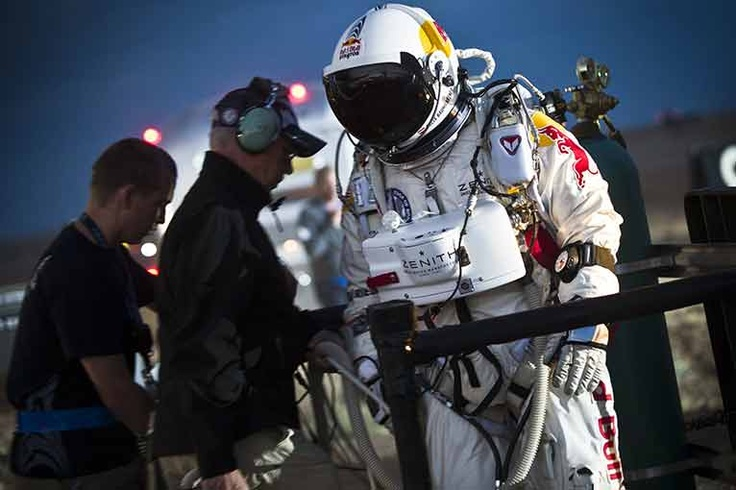 Pilot Felix Baumgartner of Austria walks toward the capsule at the flight line. This is the second test in a series of jumps that will lead to a 23-mile jump in the coming months. The third jump would break Joseph Kittinger's long-standing record for highest skydive, set in 1960.