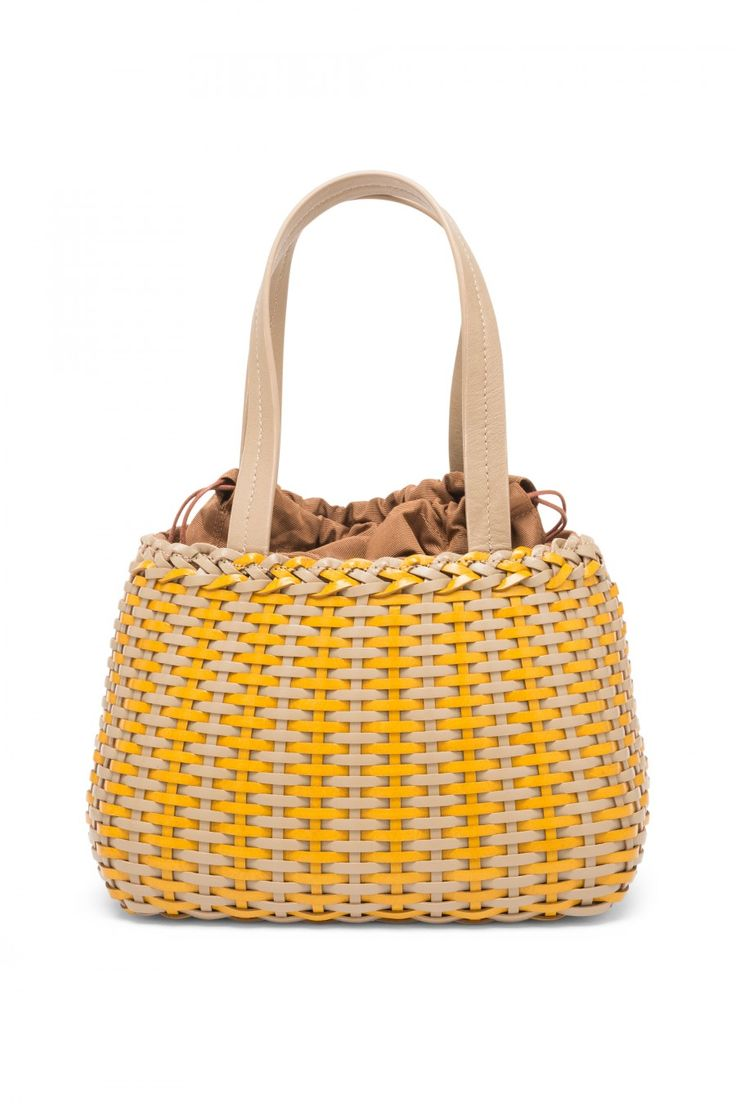 Hand woven buffalo leather bag.
