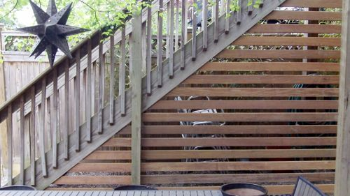 Horizontal boards tighter but I like the behind the stair and exposed different color 4X4