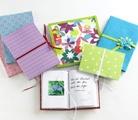 neem een lege dummy en bekleed deze met stof, vilt, lint en kralen! Maak zo je eigen dagboek, art-journal of tekenboek...