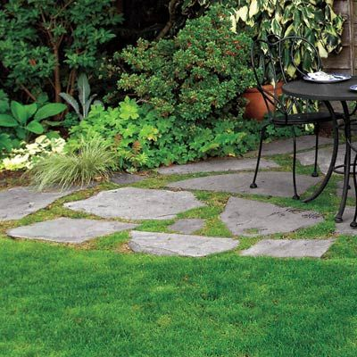 Stones in the grass.  That's some excellent budget landscaping.  Photo: Norm Plate   thisoldhouse.com   from 39 Budget-Wise Ways to Create Outdoor Rooms