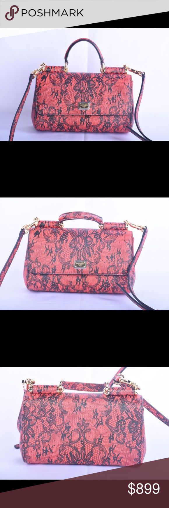 USED DOLCE AND GABANNA RED LACE HANDBAG USED DOLCE AND GABBANA RED LACE FLORAL CLUTCH HANDBAG. Messenger cross body style.  No rips, tears or holes on bag or strap. Bags Crossbody Bags