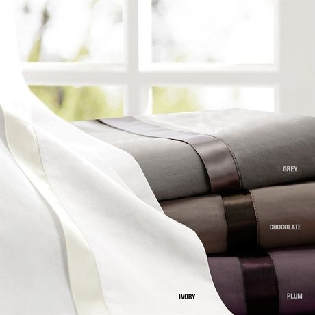 Made of a fine 100% cotton staple, these sateen sheets are woven for a smooth hand and rich look. The sheet showcases a small touch of ribbon detail on the cuff that spans the width of the flat sheet and pillowcase. The hem is created to accentuate a tonal color palette. This sheet is a smart addition with its transitional look. Available in ivory, chocolate, grey and plum color options.