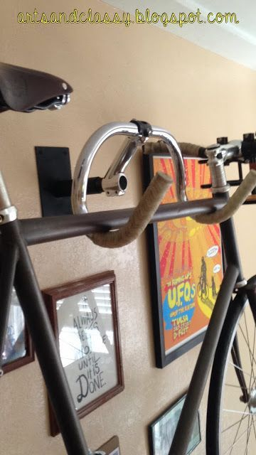 Diy Home decor ideas on a budget. : DIY Creative Bicycle Hanger Simple Storage Solution.  Use old handle bars to hold your bike up off the floor.  Can be used in a garage, or inside a room as part of the decor too.