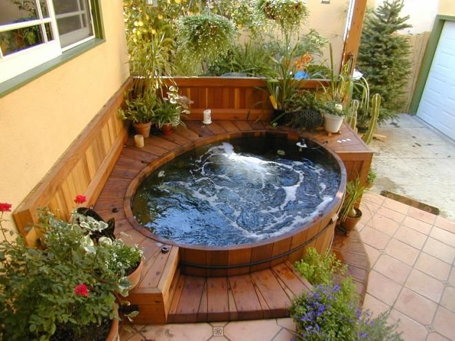Pretty but think I would want steps going up. Good for a round hot tub. – Renata Teixeira
