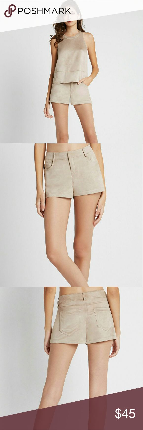 BCBGENERATION Faux Suede Short 12 Sand Sits at hips.  Banded waistline with belt hoops. Five pocket design. Center front zip with hook and eye closure. BCBGeneration Shorts