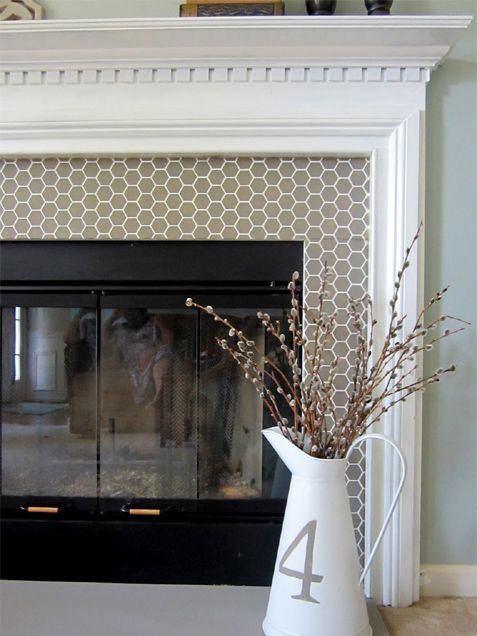 Take Your Fireplace from Drab to Fab: 8 Creative DIY Ideas to Try Blogger Jess of East Coast Creative created the look of a tile fireplace by painting the existing marble with chalk paint, which adheres to almost any surface. She then stenciled a beehive tile pattern with taupe paint. The result is taupe tile with white grout, a modern update to the classic white mantel.