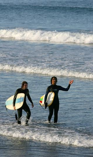 Austin Coole, 16, right, of Bridgewater and Connor Griffin, 21, of Bourne head to shore at Nantasket Beach in Hull on Tuesday, Sept. 11, 2012. Gary Higgins/The Patriot Ledger