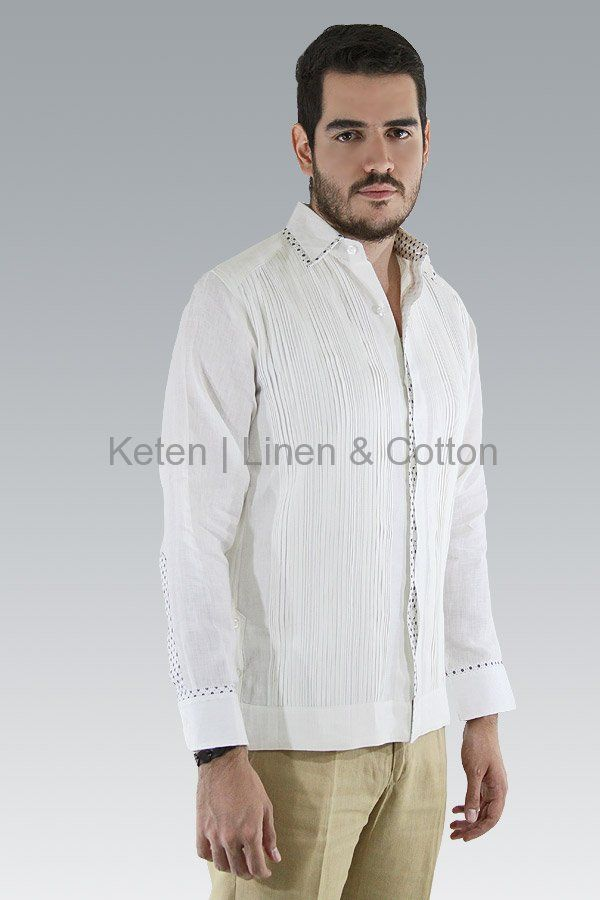Cut from Italian White Linen, long-sleeved shirt features a basic collar, button cuffs, a hidden buttoned front, Hand Knitted Tucks and combined with a printed pattern on buttons,...