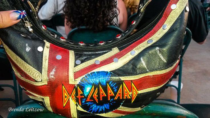 Wilson's Leather Def Leppard purse.