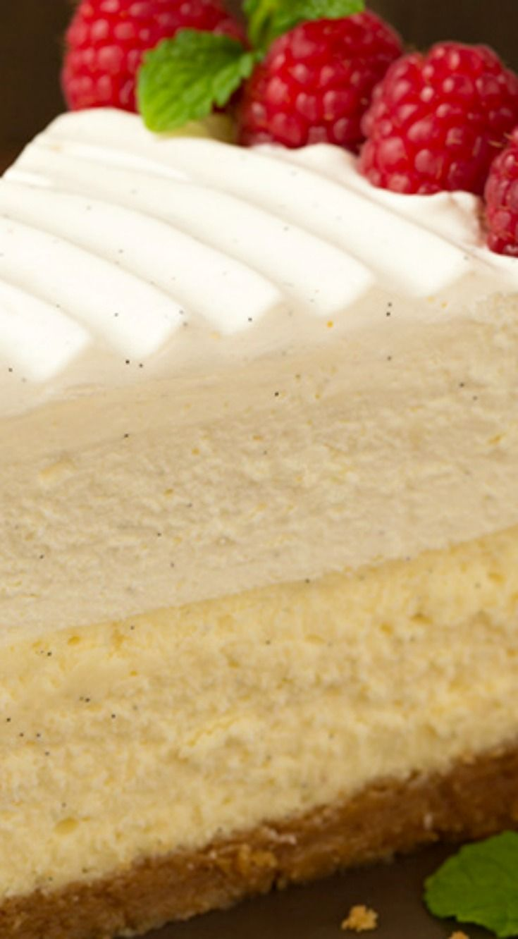 Vanilla Bean Cheesecake (Cheesecake Factory copycat) ~ This is the BEST CHEESECAKE EVER... Buttery graham crust, decadent vanilla bean cheesecake, sweet white chocolate mousse and fluffy whipped cream topping.