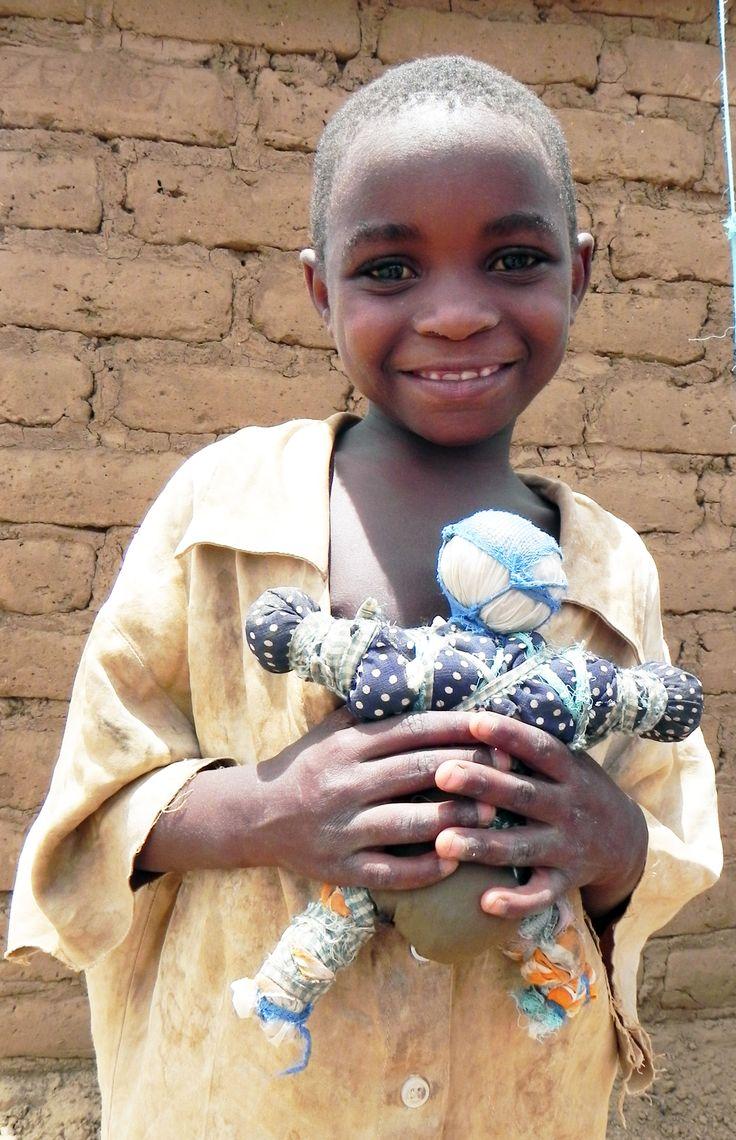 Child with doll in Kakuma Refugee Camp. http://gracemegumilee.files.wordpress.com/2011/05/2_1.jpg