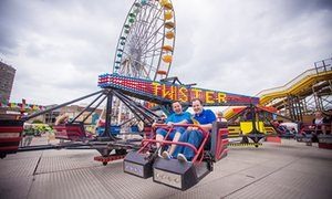 Two men ride the Twister ride at Dreamland amusement park in Margate, Kent.