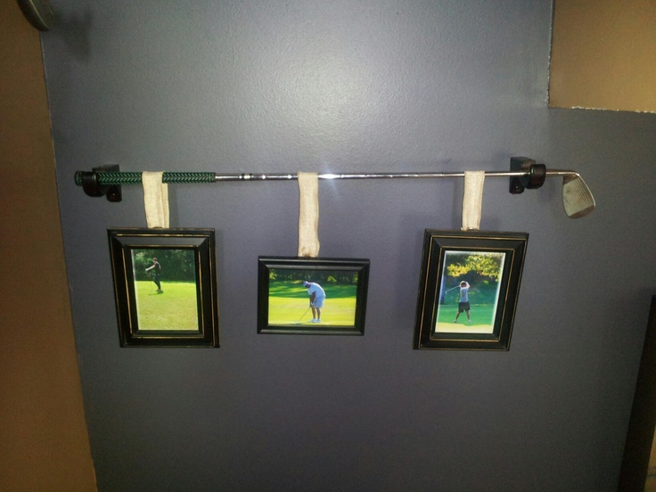 Golf club to hang pictures.  Can also use  baseball bat, tennis racket, etc.