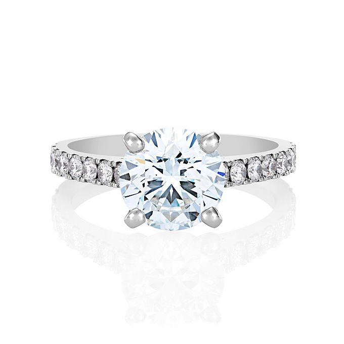 Brides.com: Round-Cut Engagement Rings. Classic pavé diamond engagement ring in platinum, price upon request, De Beers  See more De Beers engagement rings.