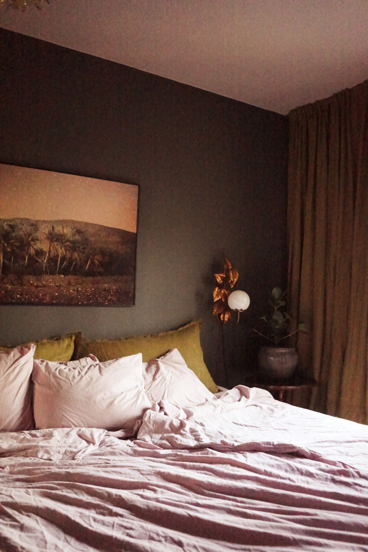 Isabelle McAllister, bedroom, green wall, green paint, himla, wonderwall, green room, palm photo, ochre, flower lamp, leaves lamp, bedroom plant, pink sheets, bedding, green bedroom, lady jotun, green marble