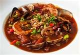 Zarzuela, a fine seafood dish filled with avacadoes, shrimp, clams, and other savory ingredients.