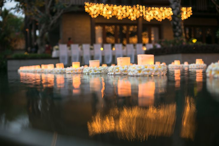 Floating Candles bedded on Plumeria glow Infinity Pool