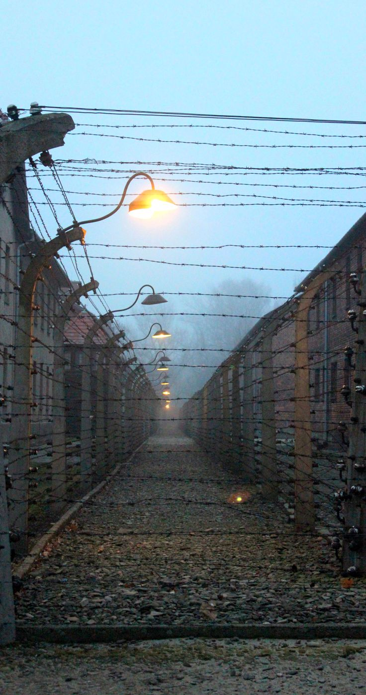 Barbed wire and eerie lighting at Auschwitz Concentration Camp, Poland www.travellinghistory.com