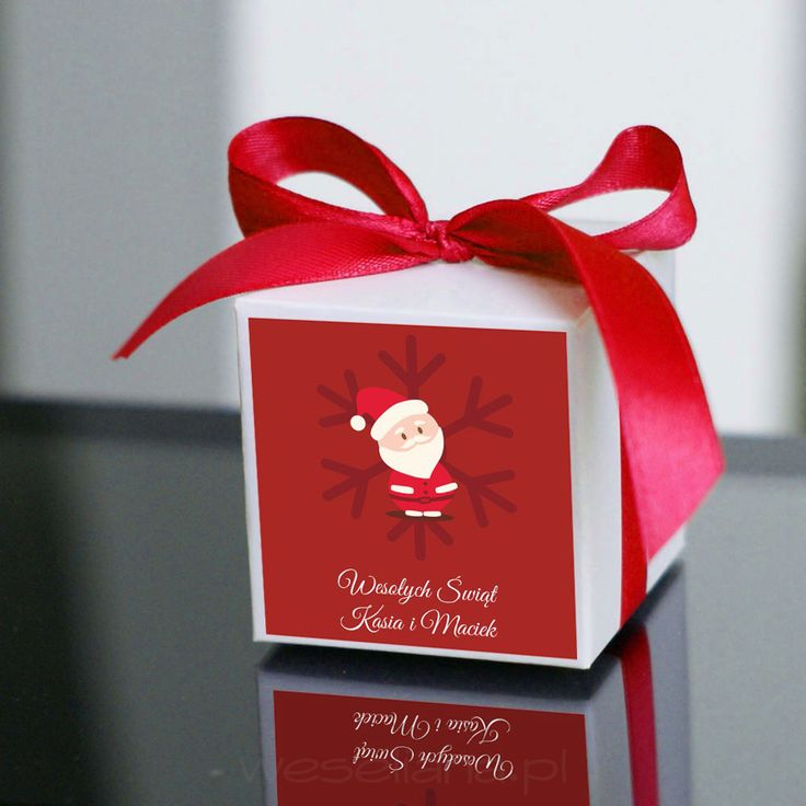 Box with a christmas card - red card with Santa Claus