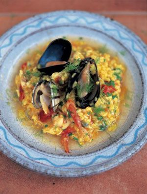 This risotto is something very special. You will need a mixture of seafood – try red mullet, monkfish, bream, John Dory, cod, mussels, clams, prawns and a little sliced squid. You can either use bought fish stock to make this risotto or you can have a go at making your own, as I do here. (Ask your fishmonger for the fish heads to use in the stock – these usually go into the bin, so you shouldn't be charged for them).