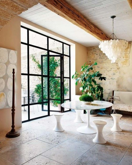 Wonderful Old Oil Mill Restored Into A Modern House : Wonderful Old Oil Mill Restored Into A Modern House With White Natural Stone Wall Chandelier Big Glass Door Sofa Chair And Ceramic Floor