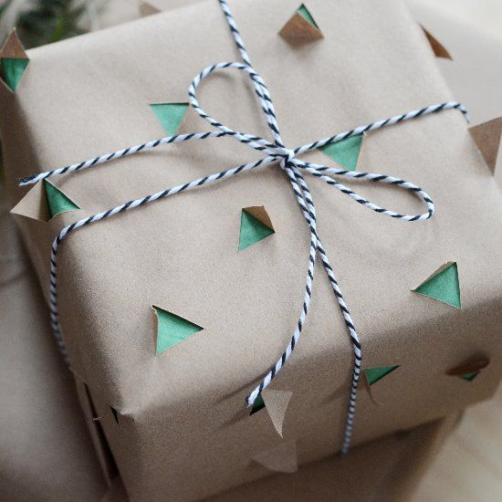 layered gift wrapping technique: colored tissue paper and brown kraft